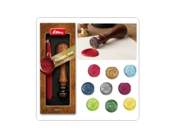 Sealing wax kit from Shiny. Includes wood handled engraved stamp, choice of 1 monogram letter (A - Z) seal and 1 stick red Waterstons sealing wax.